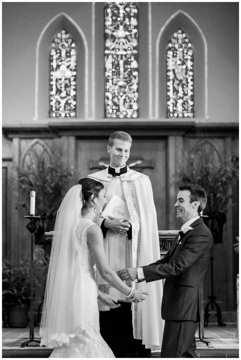 priest and newlyweds