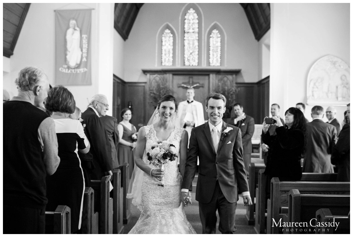 walking out of the church newlyweds photo