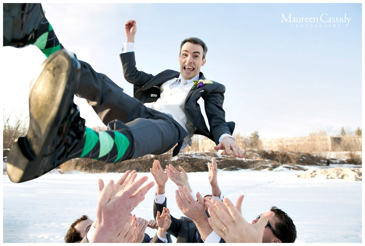 groom being thrown in the air playful wedding photo