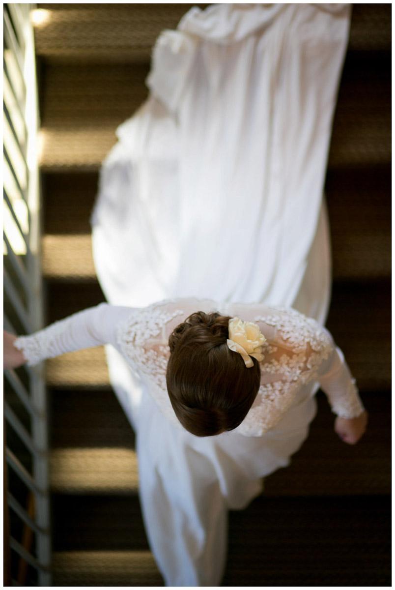 bride walking down stairs creative veiw