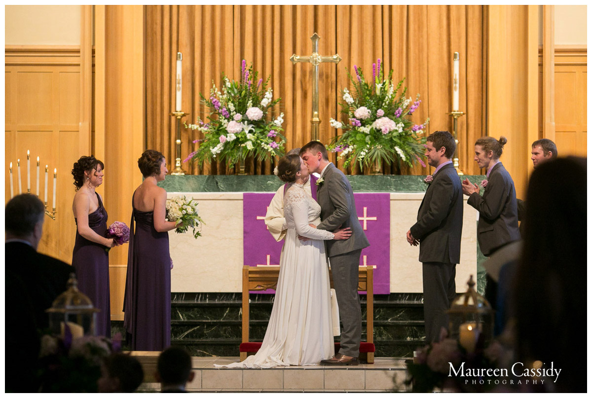 candid from wedding first kiss in madison wisconsin