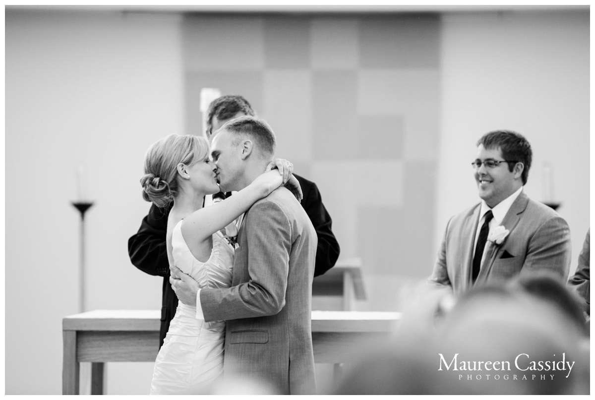 first kiss as bride and groom wi