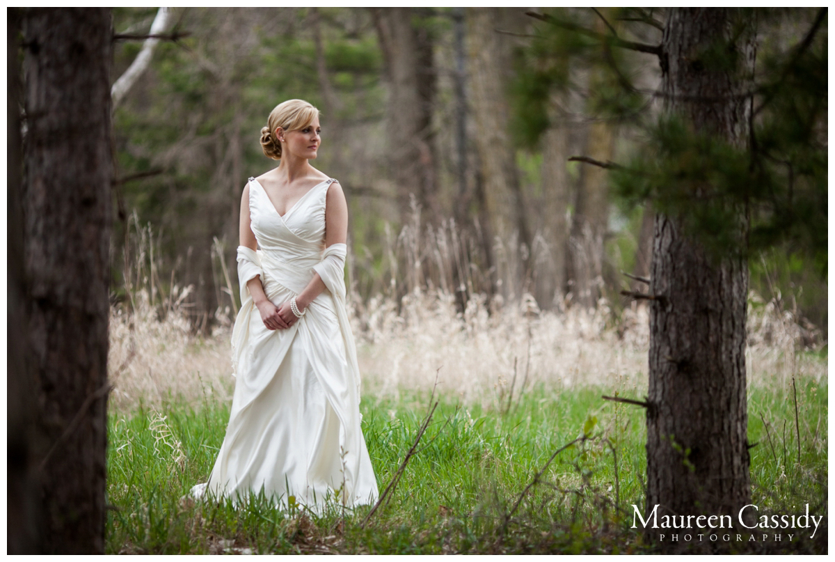 bride wearing dress in field