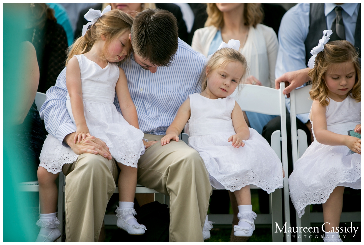 kids with dad at wedding ceremony candid