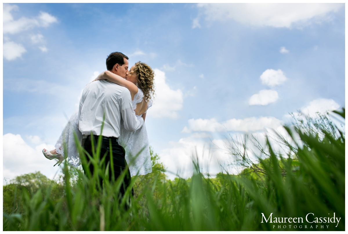 bride and groom kissing nature