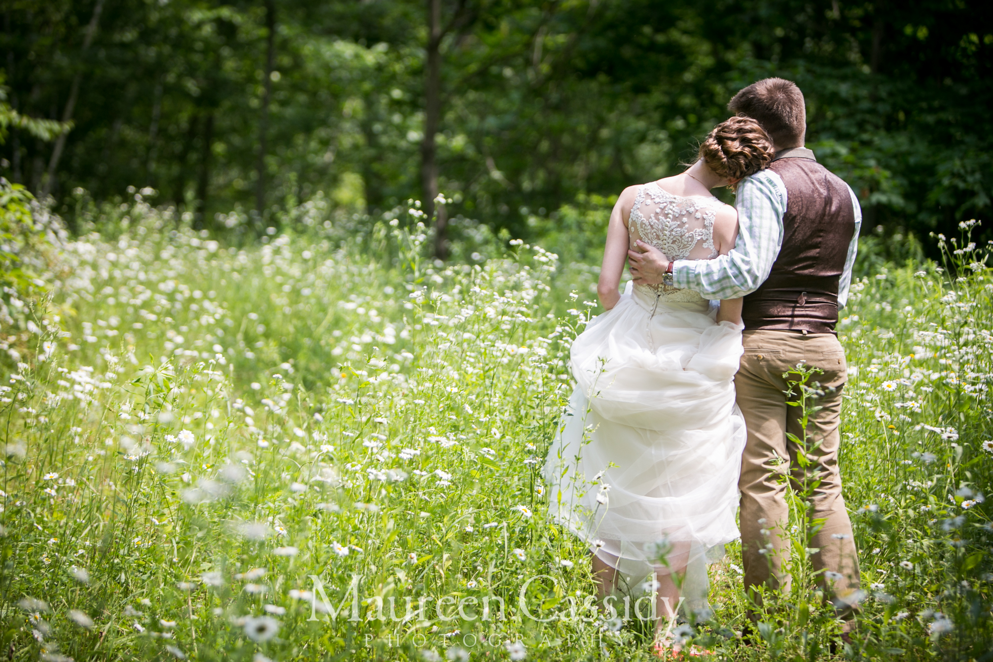 wedding at cashton barn B&B  groom holding bride canind