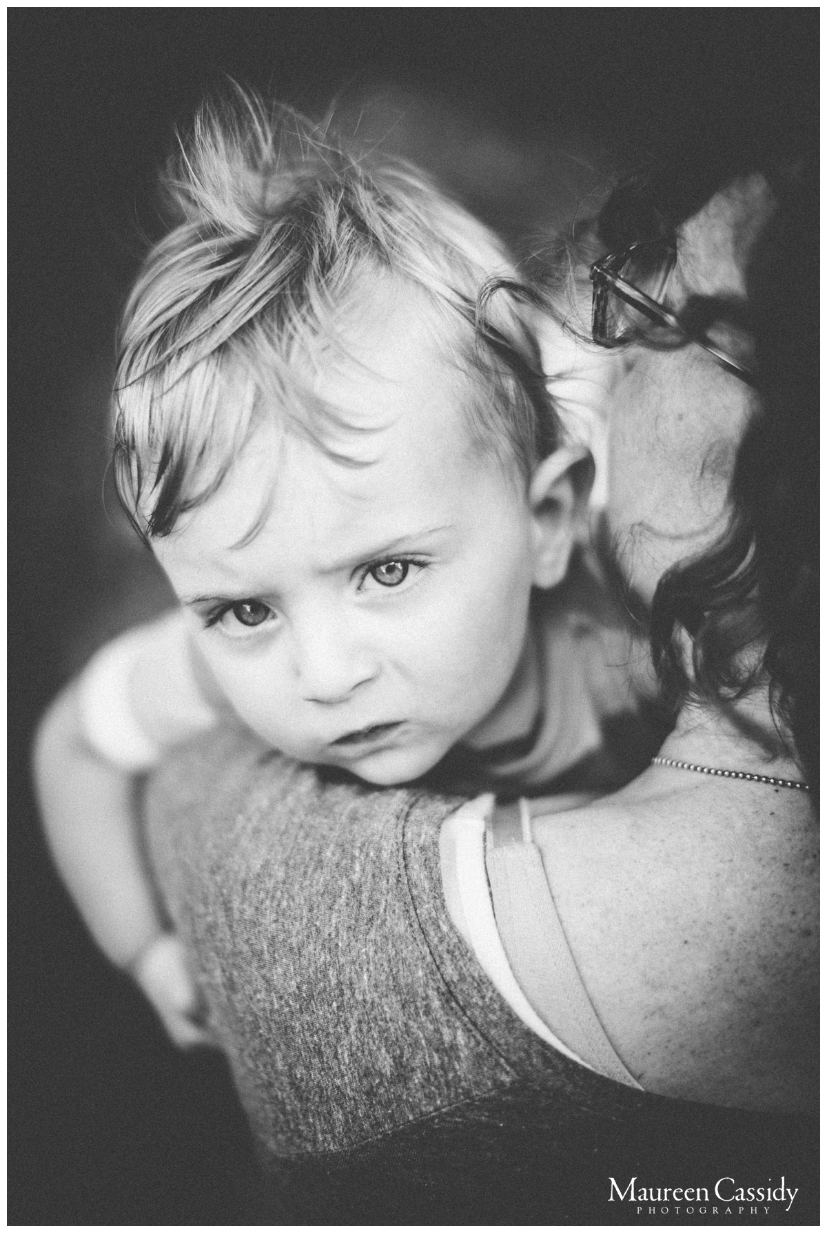 black and white mother and son hug photo