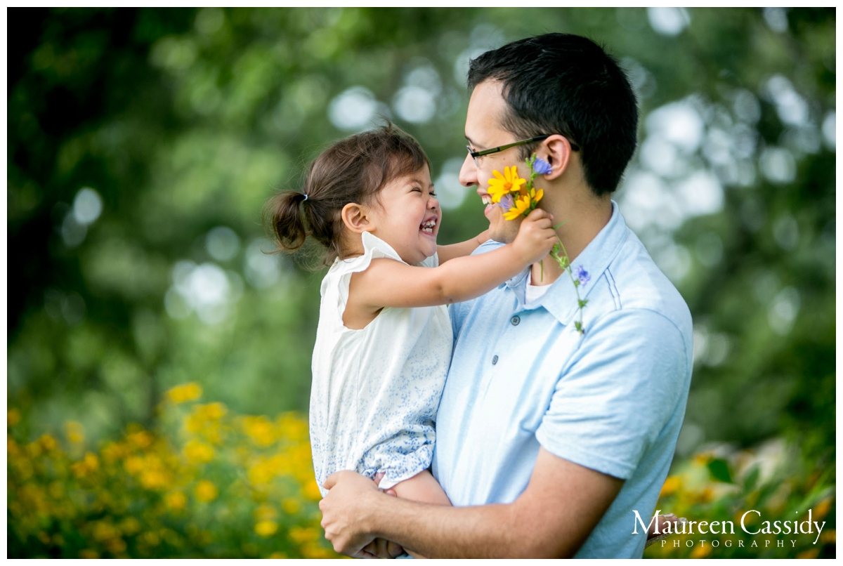 toddler with dad and flowers natural photography