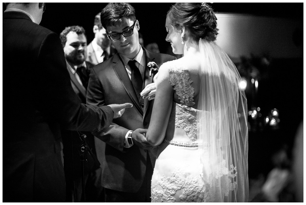 majestic theater wedding candid of exchanging wedding rings