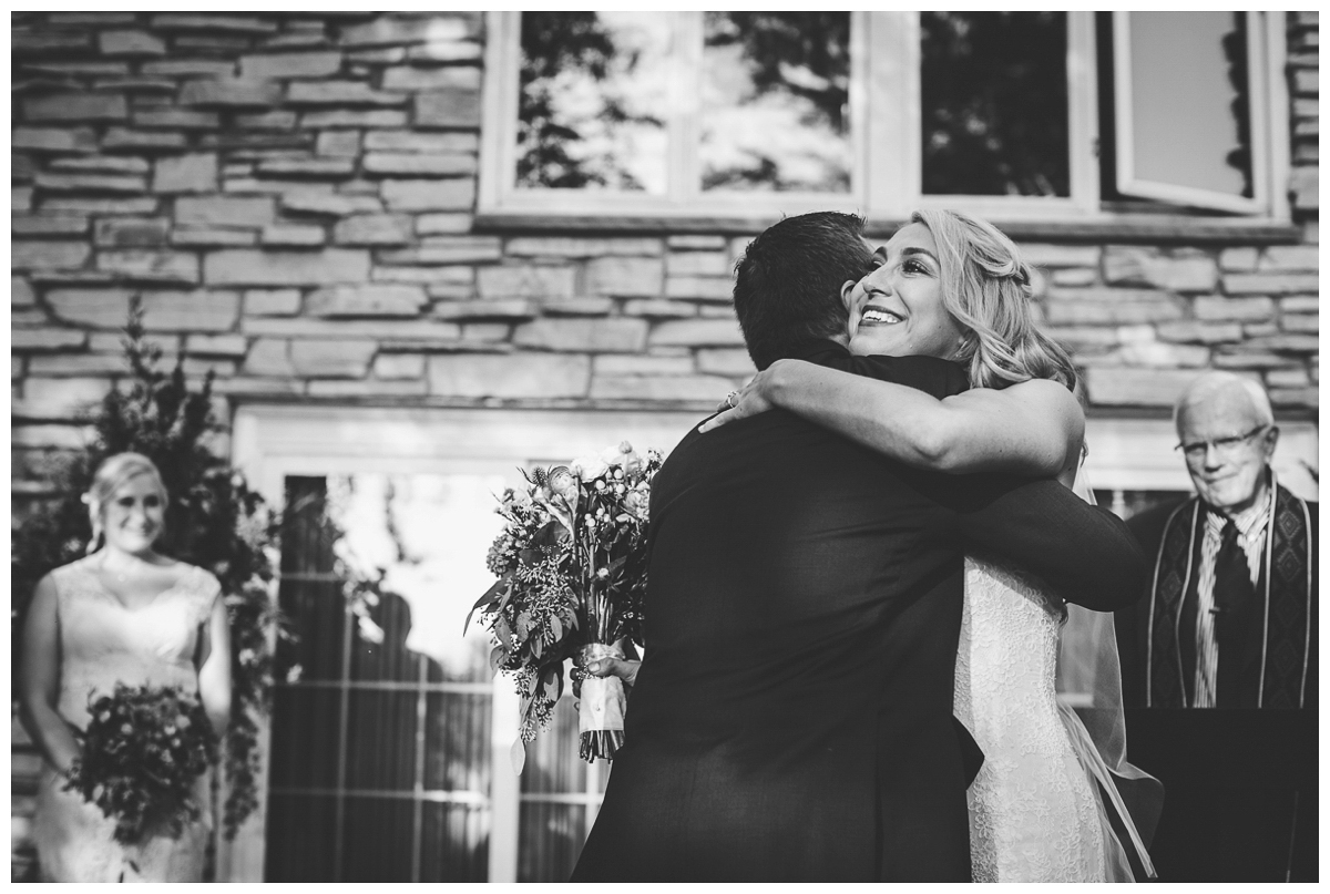 father and bride hugging wedding photo